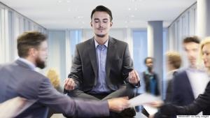 Germany, Neuss, Business man meditating on desk